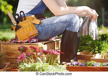 Professional gardener in wellies