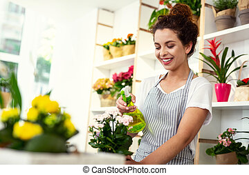 Joyful positive woman enjoying her work