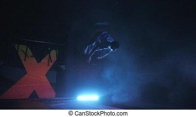 Professional Gymnast doing Tricks on Trampoline. Flips in...