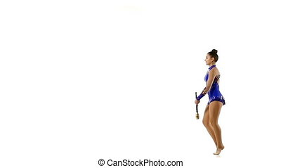 Professional gymnast performs exercises with juggling clubs, slow motion