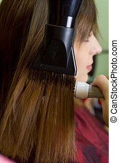 Professional hair dressing. Young girl. Hair salon. New look...