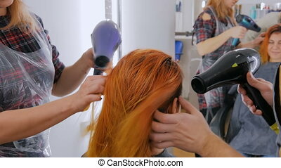 Professional hairdresser drying client hair - Professional...