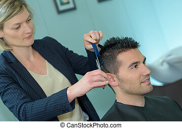 professional hairdresser in the beauty studio