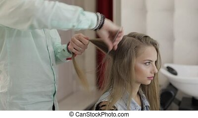 Professional hairdresser working with model hair....