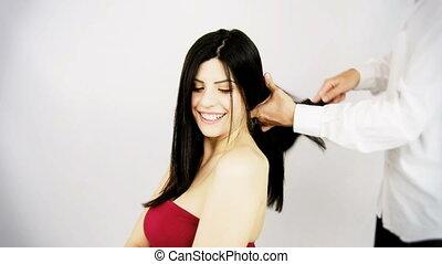 Professional hairstylist brushing - Beautiful woman getting...