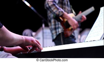Professional hand playing on keyboard synthesizer