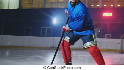 Professional hockey player attacks the gate and strikes, but the goalkeeper beats the puck. A goal in hockey. Puck scored