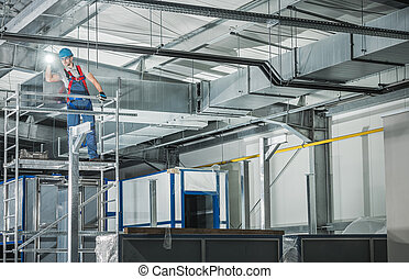Professional HVAC Technician with Flashlight Overlooking Finished Air Ventilation System