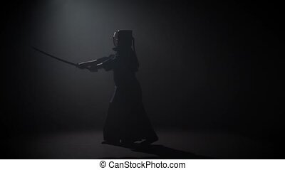 Professional Kendo fighter practicing martial art with the...