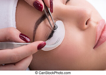 Professional lash maker working with customer