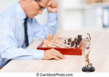 Professional lawyer playing chess
