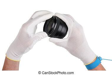 Professional maintenance and cleaning of modern lenses makes the technician in antistatic gloves.