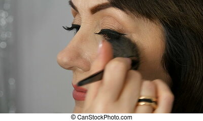 Professional make up artist makes makeup beautiful...