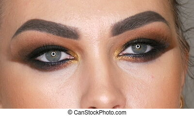 Professional make-up artist makes the makeup smoky eyes of...