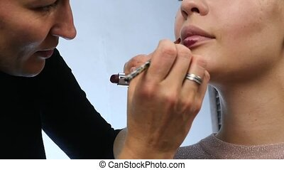 Professional make-up: Red lipstick on lips of seductive...