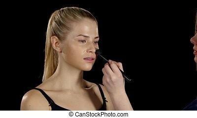 Professional makeup. Application foundation. Black