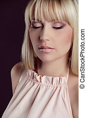 Professional Makeup. Fashion Blond Model Portrait. Hairstyle.