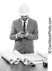 Professional male architect using his smart phone