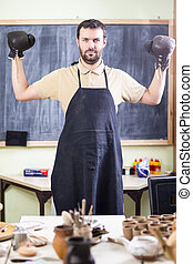 Professional Male Ceramist In Boxer Gloves. Posing in...