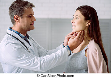 Professional male doctor looking at his patient