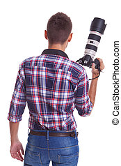 professional male photographer holding his camera