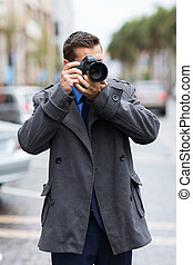 photographer taking street photos - professional male...