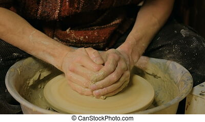 Professional male potter working in workshop - Professional...