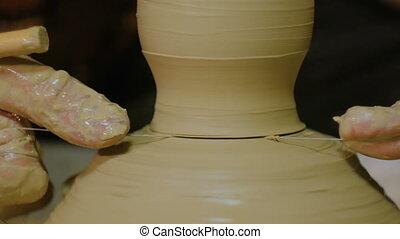 Professional male potter working in workshop, studio....