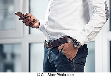 Professional man is reading message on mobile phone