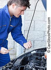Professional man repairing a car