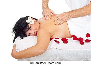 Professional masseur massaging back woman