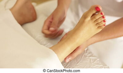 Professional masseuse treat foot - Shot of Professional...