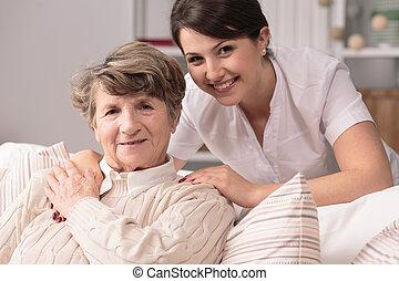 Professional medical care - Image of elderly woman having...