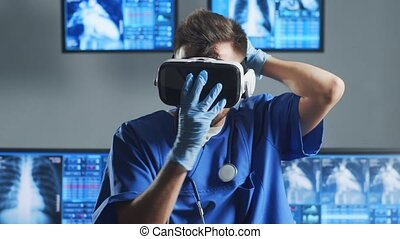 Professional medical doctor working in hospital office using computer technology. Medicine, cardiology and healthcare concept.