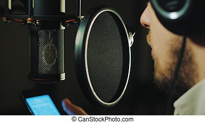 Professional Microphone in recording studio. Man reading rap