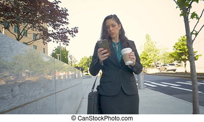 Professional millennial businesswoman on mobile phone...