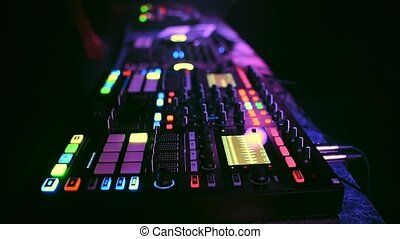 professional modern DJ controller for mixing electronic music with DJ hands