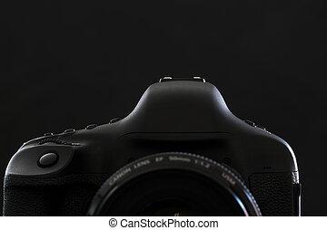 Professional modern DSLR camera low key stock photo/image