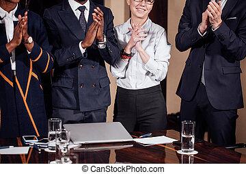 multiracial business team applauding in meeting room