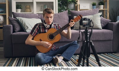 Professional musician blogger is recording tutorial about...