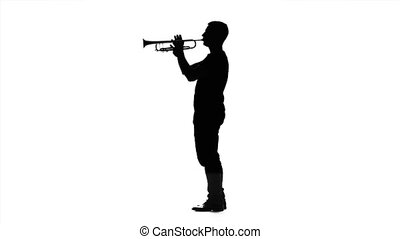 Professional musician playing on trumpet in slow motion. Black silhouette