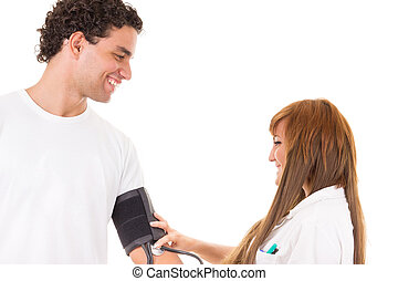 professional nurse or doctor measures the blood pressure of a satisfied and smiling patient