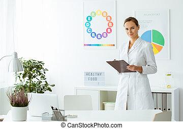 Professional nutritionist in white uniform