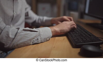 Professional office worker using computer in the evening