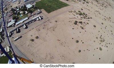 Professional parachute jumper parachuting above arizona....