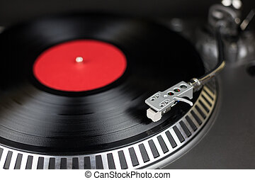 Professional party djs turntable with red and balck record....