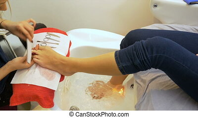 Professional pedicure beauty procedure performed at salon