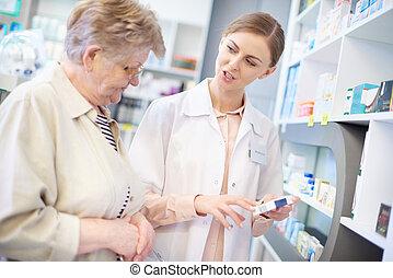 Professional pharmacist explaining prescription