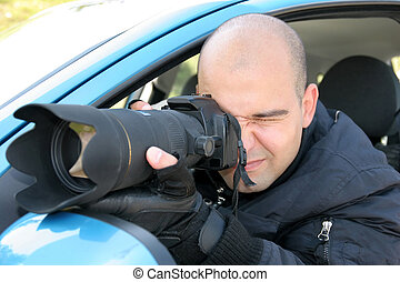 Professional photographer in action, paparazzi -...