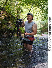 Professional photographer with camera on tripod